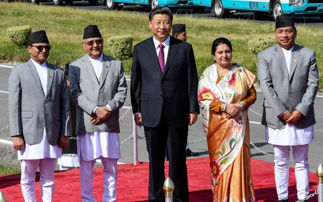 (L-R) Chairman of National Assembly of Nepal Ganesh Prasad Timilsina, Nepal's Prime Minister KP Sharma Oli, China's President Xi Jinping, Nepal's President Bidhya Devi Bhandari and Vice President Nanda Kishor Pun, look on as Xi Jinping is about to leave, wrapping up his two-day visit to Nepal, in Kathmandu on October 13, 2019. Prakash Mathema/Pool via REUTERS