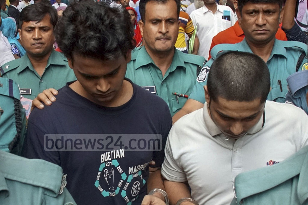 Police escorting out BUET students Shamim Billah and Moaz Abu Horaira after a Dhaka court remanded the Abrar Fahad murder suspects in custody for five days on Sunday.