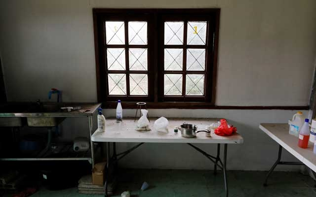 A small meth lab, which police suspect was used to experiment with new recipes, is seen inside a raided compound belonging to Sue Songkittikul, a suspected Sam Gor syndicate operations chief, in Mae Sot, Thailand May 13, 2019. Reuters