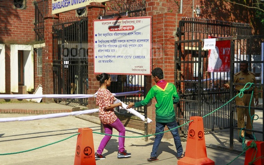A candidate rushing into the BUET admission test centre minutes before the exams on Monday.