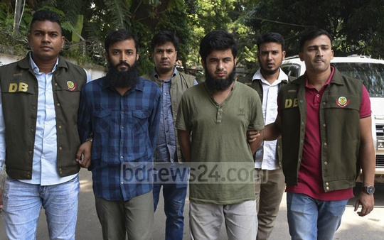 Police's Detective Branch personnel escorting two suspected militants to their Minto Road office in Dhaka on Monday after arresting them in Mohammadpur area.