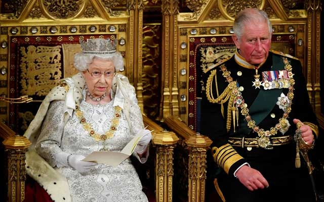 Britain's Queen Elizabeth delivers the Queen's Speech during the State Opening of Parliament, next to Charles, Prince of Wales, in London, Britain October 14, 2019. REUTERS