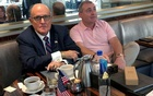 FILE PHOTO: US President Donald Trump's personal lawyer Rudy Giuliani has coffee with Ukrainian-American businessman Lev Parnas at the Trump International Hotel in Washington, US, Sep 20, 2019. REUTERS