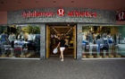 FILE PHOTO: A woman walks into a store of yogawear retailer Lululemon Athletica in downtown Vancouver June 11, 2014. Reuters