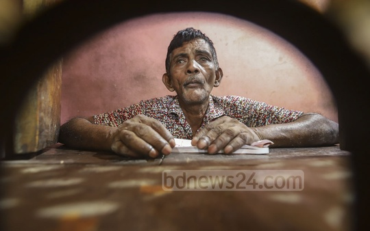 Kafil Uddin, 65, has been selling tickets at the counter of Rajmoni-Rajia theatres in Dhaka's Kakrail since the cinema hall was opened for the first time. He has witnessed the struggles of the theatre and its heydays. Photo: Abdullah Al Momin