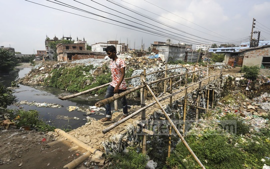 More than a year after the relocation of Dhaka's tannery industry from Hazaribagh, a garbage-filled canal in that area has yet to be cleared. Photo: Asif Mahmud Ove