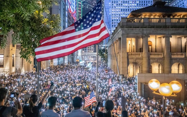 Anti-government protesters, some waving the flag of the US, rally in central Hong Kong on Monday, Oct 14, 2019 The New York Times
