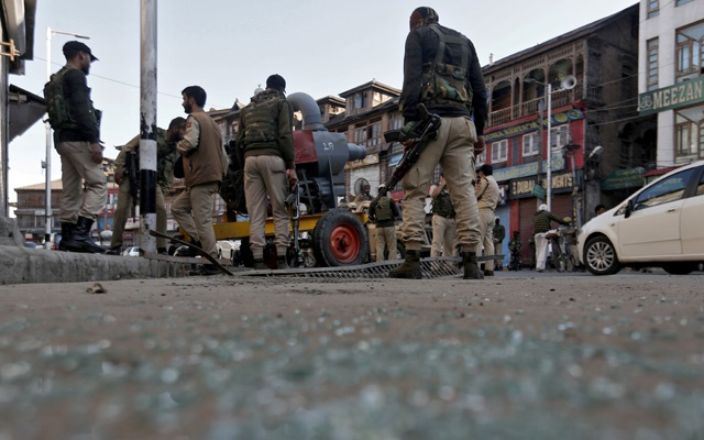 File Photo: Indian police officers stand at the site of a grenade attack in Srinagar Oct 12, 2019. REUTERS