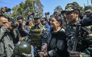 A women is arrested at a rally in Srinagar, India, on Tuesday, Oct 15, 2019, where protesters expressed their outrage that many of Kashmir's political leaders, including a member of parliament, remain in detention. The New York Times