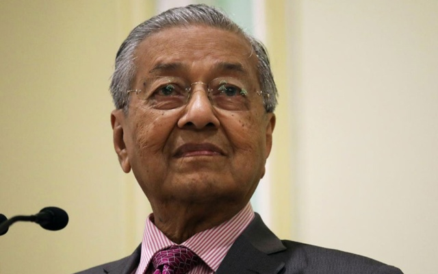 FILE PHOTO: Malaysia's Prime Minister Mahathir Mohamad reacts during a news conference in Putrajaya, Malaysia, Sep 18, 2019. REUTERS