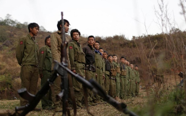 File Photo: Rebel soldiers of Myanmar National Democratic Alliance Army (MNDAA) gather at a military base in Kokang region, Mar 11, 2015. REUTERS