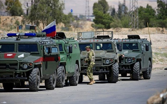 Russian military vehicles are seen in eastern Ghouta near Douma, in Damascus, Syria Apr 23, 2018. REUTERS/Ali Hashisho