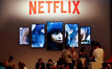 File Photo: Gamers and visitors take a rest at the booth of Netflix during Europe's leading digital games fair Gamescom, which showcases the latest trends of the computer gaming scene in Cologne, Germany, Aug 21, 2019. REUTERS