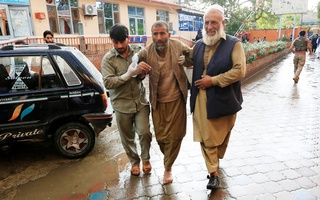 Men carry an injured person to a hospital after a bomb blast at a mosque, in Jalalabad, Afghanistan October 18, 2019. Reuters