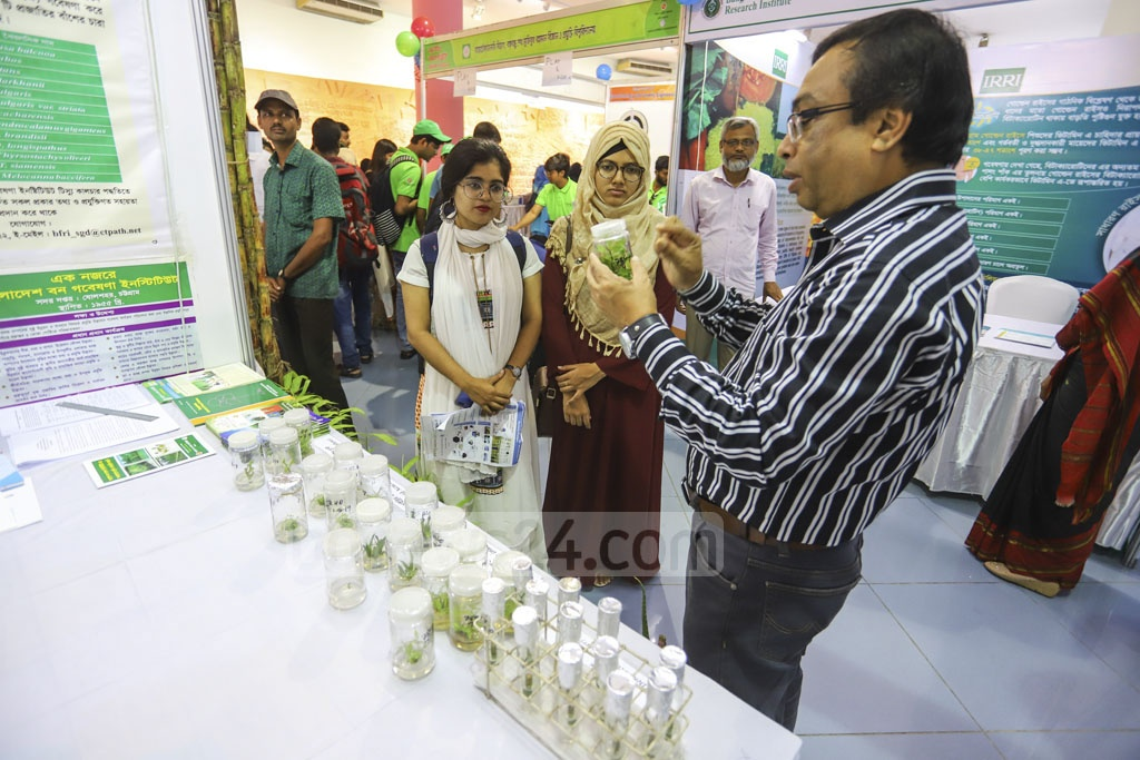 Visitors check out a stall at the National Biotechnology Fair being held at the capital's Bangabandhu Novo Theatre. Photo: Asif Mahmud Ove