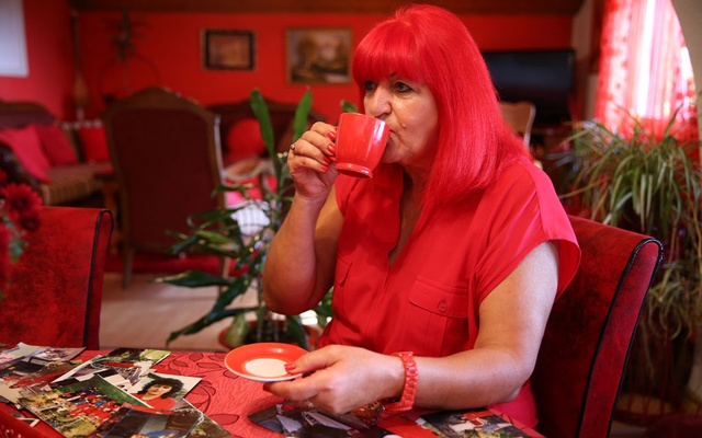 Zorica Rebernik, obsessed with the red color, drinks coffee in her house in the village of Breze near Tuzla, Bosnia and Herzegovina October 16, 2019. Reuters