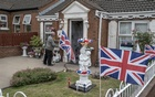 FILE -- British flags outside a home in Belfast, Northern Ireland, July 12, 2018. Unionists in Northern Ireland feel betrayed by British Prime Minister Boris Johnson's decision to sign off on a Brexit deal with the European Union without support from the lawmakers who represent them. (Andrew Testa/The New York Times)