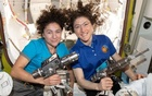 The astronauts Jessica Meir, left, and Christina Koch, aboard the International Space Station. The New York Times