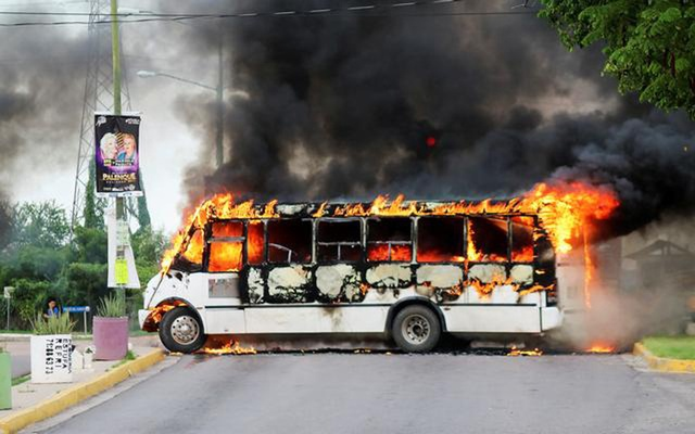 A burning bus, set alight by cartel gunmen to block a road, is pictured during clashes with federal forces following the detention of Ovidio Guzman, son of drug kingpin Joaquin 'El Chapo' Guzman, in Culiacan, Sinaloa state, Mexico October 17, 2019. REUTERS