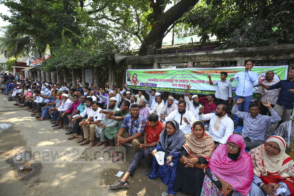 Disgruntled teachers stage a sit-in protest in front of the National Press Club for a fourth day on Friday to demand inclusion in the government's monthly pay order scheme.