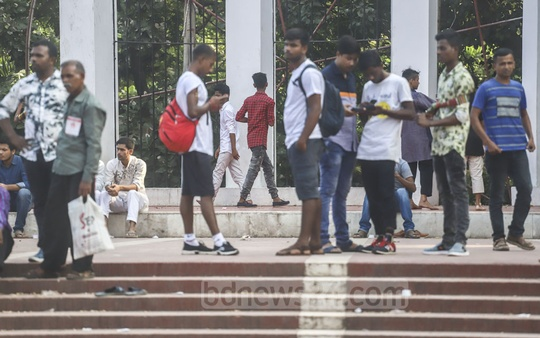 People hanging out at the main altar of the Central Shaheed Minar in Dhaka wearing shoes on Friday though it is forbidden to keep shoes on at the site erected in honour of the Language Movement martyrs. Photo: Abdullah Al Momin