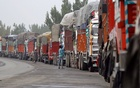 Supply trucks loaded with apples are seen parked along a highway near Qazigund in south Kashmir's Anantnag district, Oct 17, 2019. REUTERS