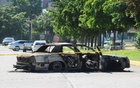 The burnt wreckage of a police patrol car is seen a day after cartel gunmen clashed with federal forces, resulting in the release of Ovidio Guzman from detention, the son of drug kingpin Joaquin 'El Chapo' Guzman, in Culiacan, in Sinaloa state, Mexico October 18, 2019. REUTERS