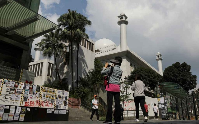 People go about their day outside Kowloon Masjid and Islamic Centre in Hong Kong's tourism district Tsim Sha Tsui, China, Oct 21, 2019. REUTERS