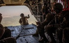 US military personnel fly over Afghanistan's Helmand province in a helicopter on Sept 26, 2019. The New York Times
