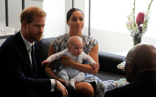 The Duke and Duchess of Sussex with their son, Archie, during a visit with Archbishop Desmond Tutu in Cape Town in September. The New York Times