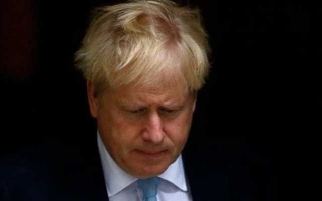 FILE PHOTO: Britain's Prime Minister Boris Johnson leaves Downing Street in London. REUTERS