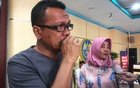 Epi Samsul Komar, 52, a relative of a victim of crashed Lion Air flight JT610 reacts as he speaks to reporters after Indonesian investigators told victims' families mechanical and design issues contributed to the crash of the 737 MAX jet last year, in Jakarta, Indonesia, Oct 23, 2019. REUTERS