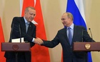 Russian President Vladimir Putin shakes hands with Turkish President Tayyip Erdogan during a news conference following their talks in Sochi, Russia October 22, 2019. Sputnik via REUTERS