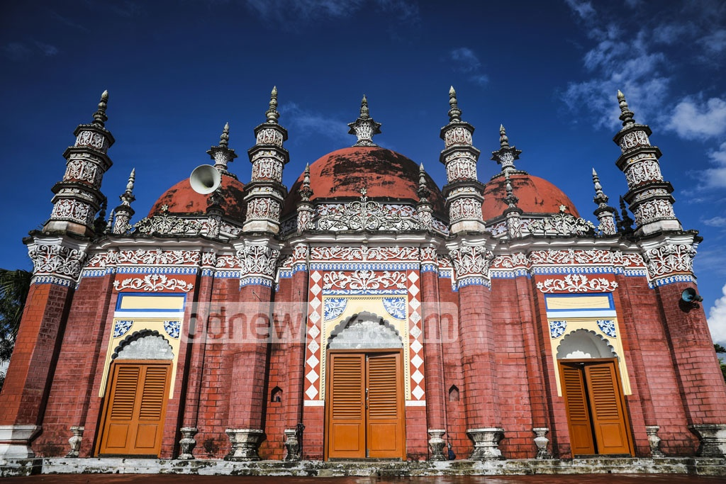 It is a three-domed mosque sitting on a rectangular-shaped platform. The central dome is larger than the other two. Photo: Mostafigur Rahman