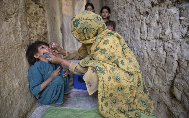 FILE Photo: A health worker gives a polio vaccine to a child in Dukki, Pakistan, Apr 24, 2018.Global health officials announced Oct 23, 2019, that two of the three strains of wild polio virus have officially been eliminated. Only polio virus Type 1 persists, and only in Pakistan and Afghanistan. The New York Times
