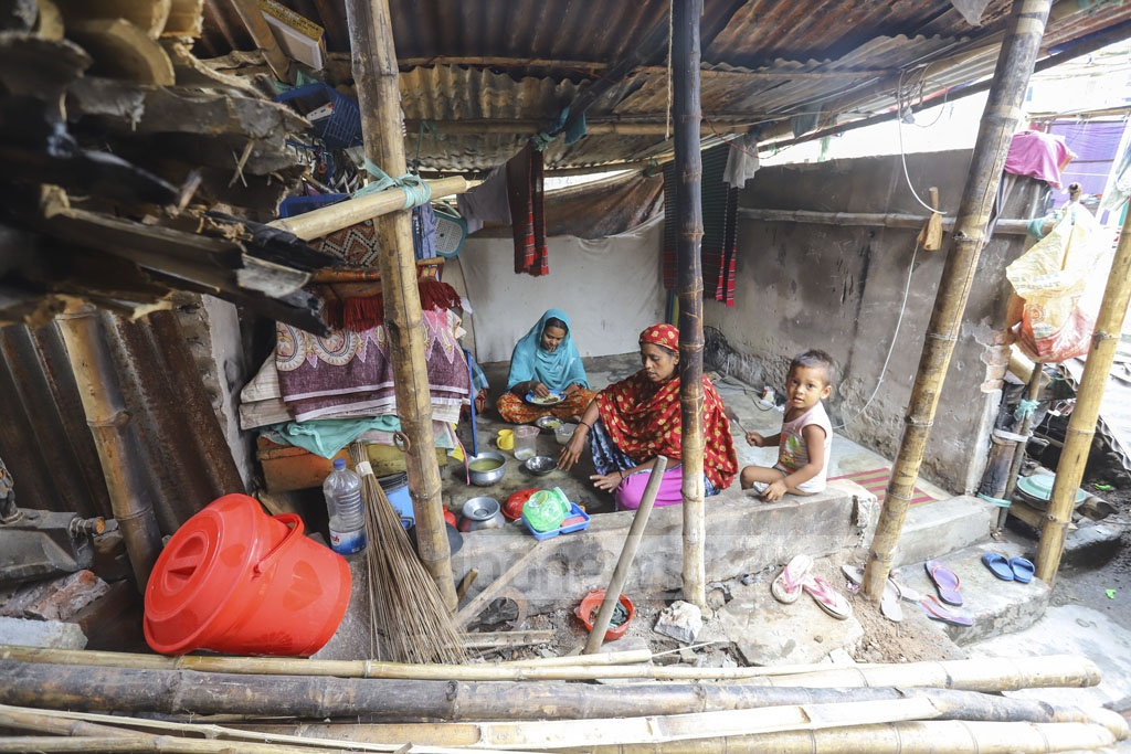 Members of family lead their daily in a tent where their home once stood. Photo: Asif Mahmud Ove