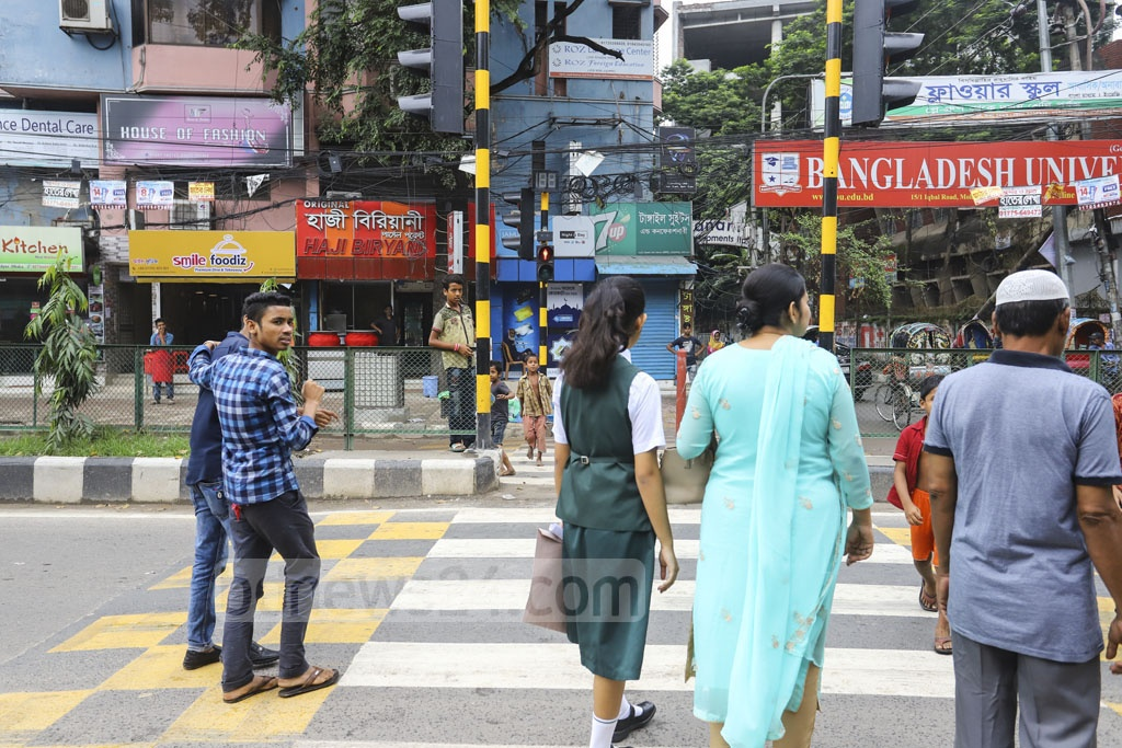 Jaywalkers crossing the street despite the red light for pedestrians at a zebra crossing with push-to-walk button at Mohamadpur in Dhaka. Photo: Asif Mahmud Ove