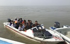 Passengers travel on speedboats without life jackets across the Jamuna River on the risky Aricha-Kazirhat route. Photo: Mostafigur Rahman