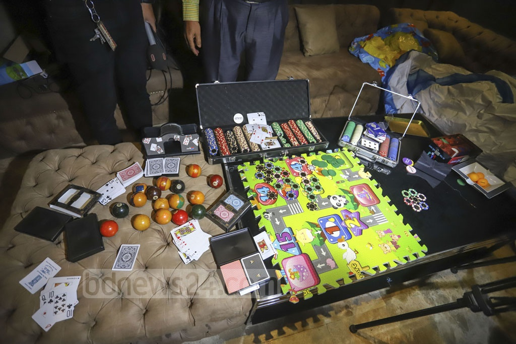 The Department of Narcotics Control seized a huge amount of illegal liquor and gambling equipment in a raid on the home of controversial businessman Aziz Mohammad Bhai in Dhaka's Gulshan on Sunday. Photo: Asif Mahmud Ove
