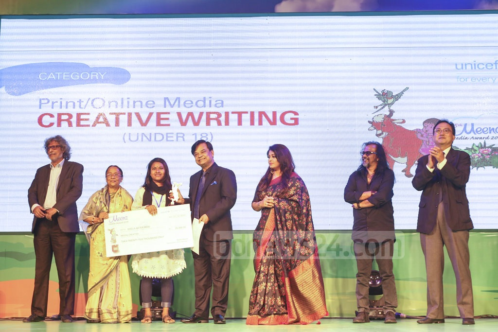 Shela Akhter Mou, a child journalist of monglanews24.com's Hello, receiving the award after winning the second place in under-18 creative writing in print and online media category at a ceremony organised at Sonargaon Hotel on Sunday. Photo: Mahmud Zaman Ovi