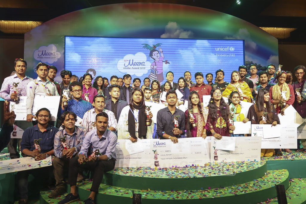 Winners pose for a group photograph with guests at the Meena Media Awards 2019 ceremony organised at Sonargaon Hotel on Sunday. Photo: Mahmud Zaman Ovi