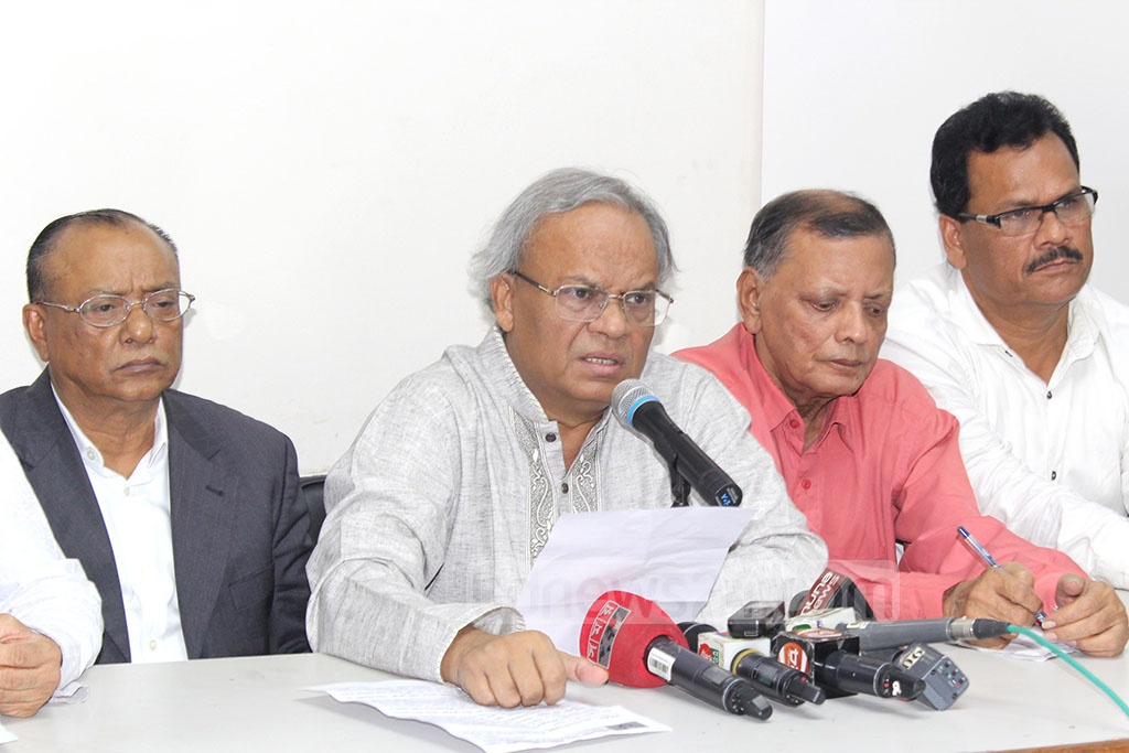BNP's Senior Joint Secretary General Ruhul Kabir Rizvi addresses the media at the party headquarters on the BSMMU authority's statement over the health of Chairperson Khaleda Zia on Monday.