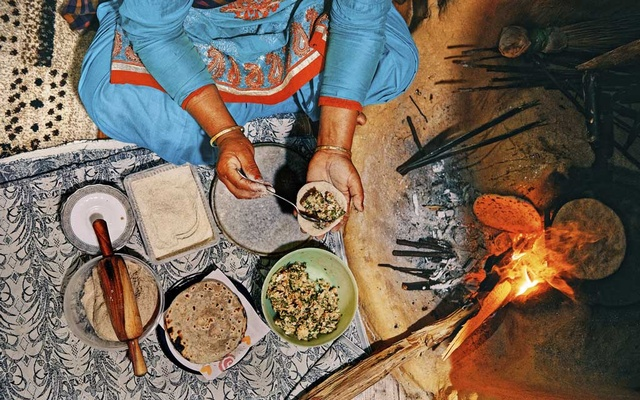 A woman making stuffed roti at the Kalasan Nursery Farm near the town of Karsog in Himachal Pradesh, India, April 7, 2019. In Himachal Pradesh, the northern Indian state straddling the Western Himalayas, Punjabi and Tibetan flavours meet. The New York Times