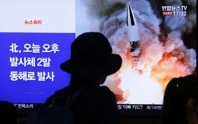 People watch a TV broadcast showing a file footage for a news report on North Korea firing two projectiles, possibly missiles, into the sea between the Korean peninsula and Japan, in Seoul, South Korea, Oct 31, 2019. REUTERS