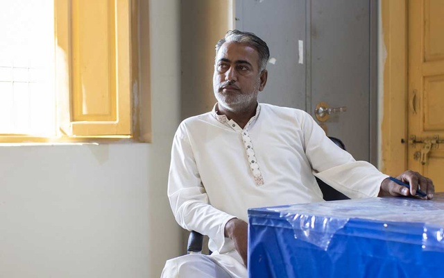 Dr Muzaffar Ghanghro, on Oct 24, 2019 in Ratodero, Pakistan, is now practicing at a government-run hospital after his private practice was shuttered. The paediatrician is accused of reusing syringes and infecting scores of Pakistani children with HIV. The New York Times