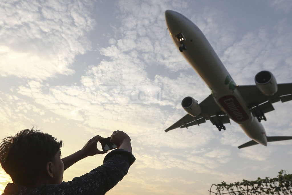 Many take photos of planes flying on Baunia Road at Jasimuddin in Dhaka's Uttara next to Hazrat Shahjalal International Airport.