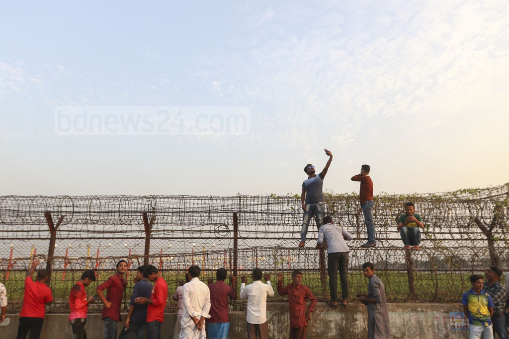 Many scale barbed wire fence on Baunia Road in Dhaka's Uttara along Shahjalal International Airport though it is forbidden.