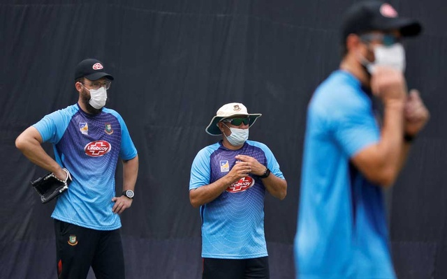 Bangladesh's bowling coach Daniel Vettori, head coach Russell Domingo and batting coach Neil McKenzie wearing masks look on during a practice session ahead of their Twenty20 cricket match against India in New Delhi, India, November 1, 2019. Reuters