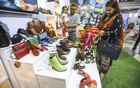 Visitors browse items at Bangladesh Leather Footwear & Leather Goods International Sourcing Show 2019 (BLLISS)at the International Convention City Bashundhara in Dhaka on Friday. Photo: Asif Mahmud Ove