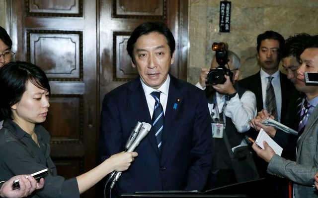 Japan's trade minister, Isshu Sugawara, resigned after being accused of giving melons and crab to voters. The New York Times
